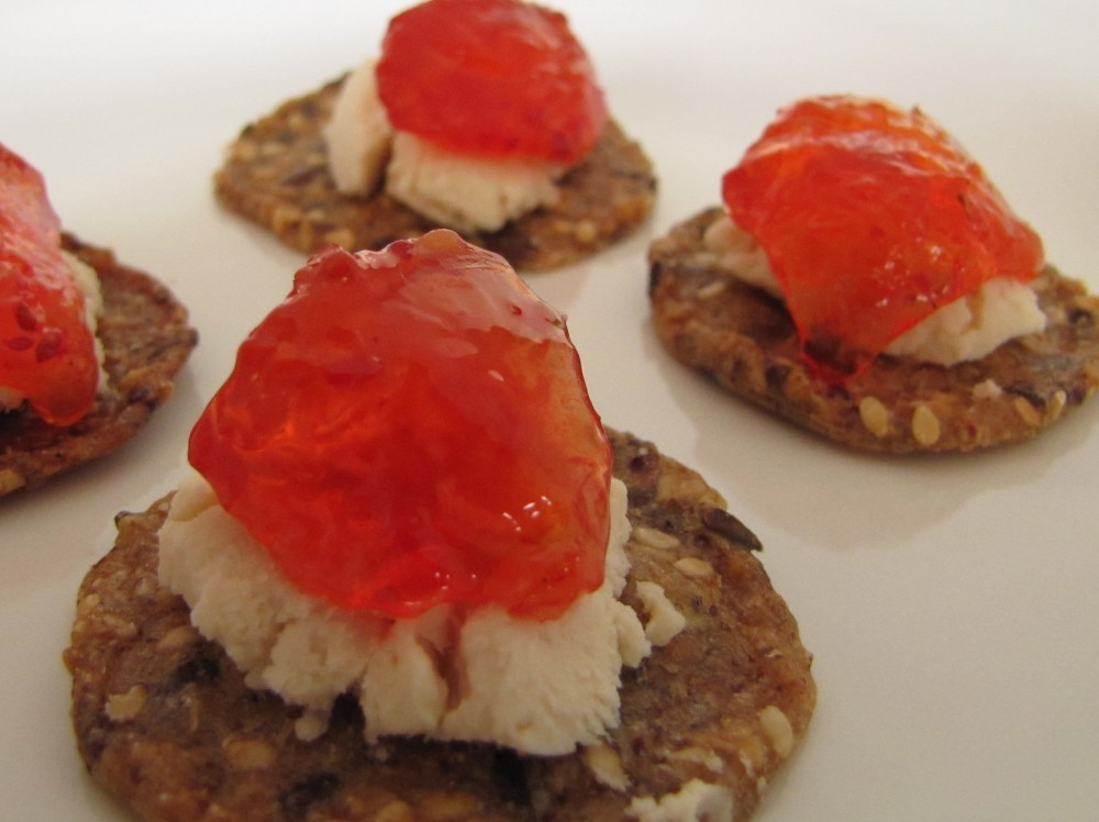 Cranberry pepper jelly on gluten free rice crackers with goat cheese