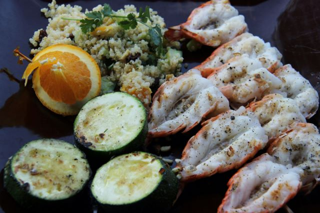 Citrus quinoa salad served with fried zucchini and grilled shrimp - easy, healthy and delicious!