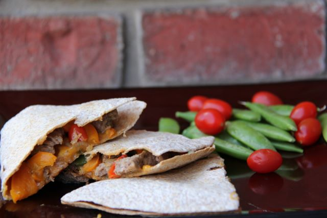 Spicy steak and vegetable quesadilla is packed full of vegetables and melt in your mouth steak pieces